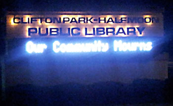 our community mourns library sign