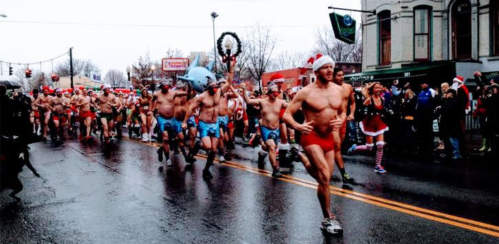 runners in the Santa Speedo Sprint running down Lark Street