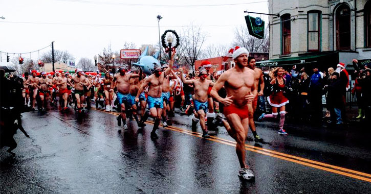runners in the Santa Speedo Sprint running down Lark Street