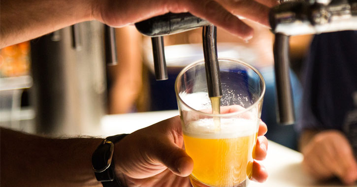 beer going into a glass from a tap