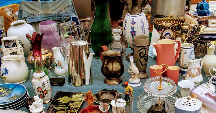 a spread of flea market items on a table
