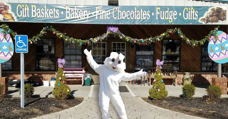 the Easter Bunny posing in front of a store