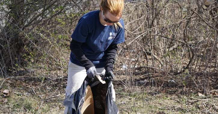 woman picking up trash