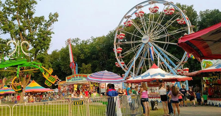a ferris wheel and other rides at the fair