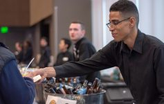 man serving food and beer samples