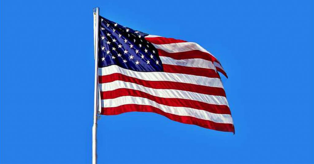 large american flag waving in the air