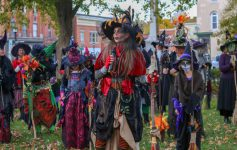 women dressed as witches in a park