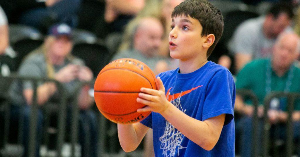 boy preparing to throw basketball