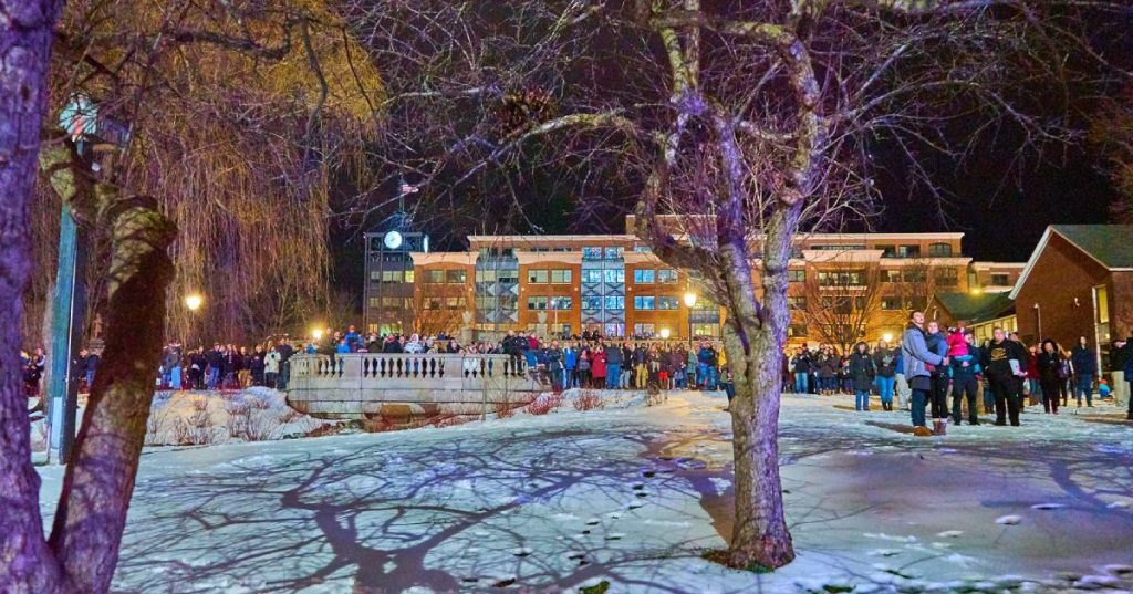 people outdoors at winter night event