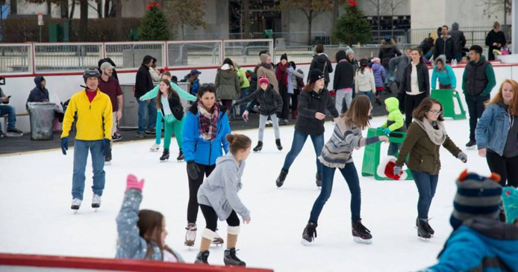 people ice skating outdoors
