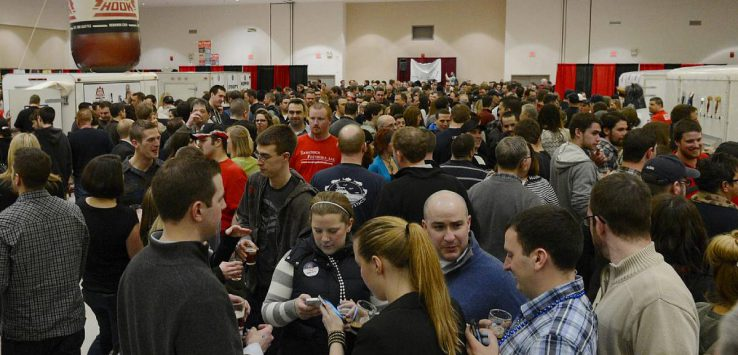 group of people at a beer sampling event indoors