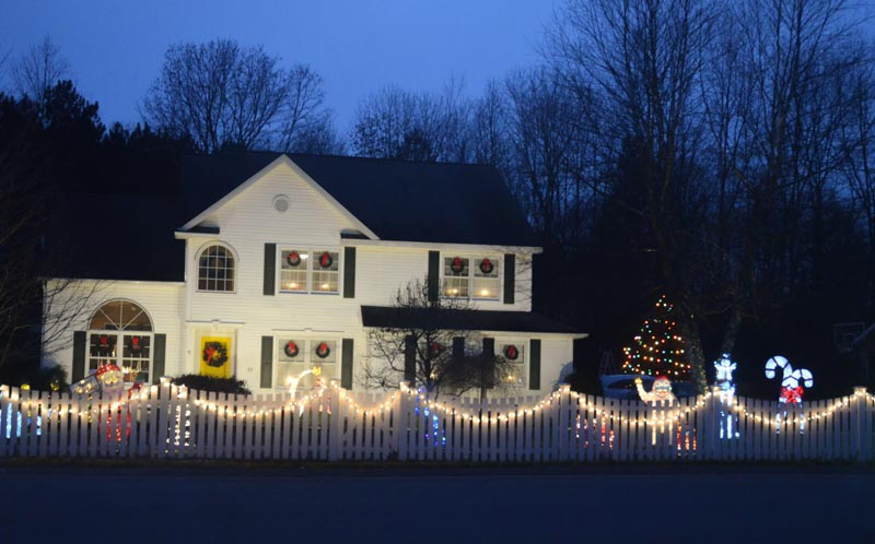 home decorted with lights and characters in the heritage green neighborhood in clifton park ny