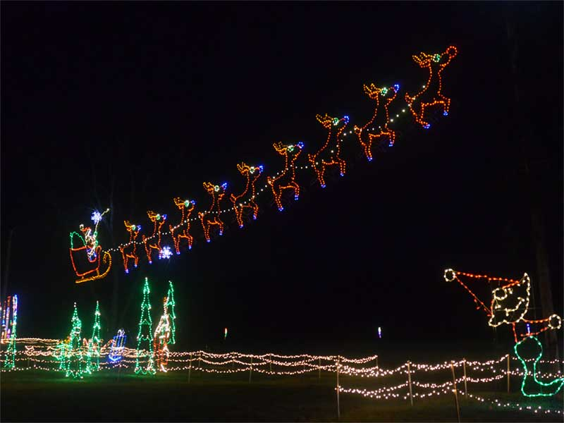 Santa and his reindeer in lights at Quick Response in Round Lake NY