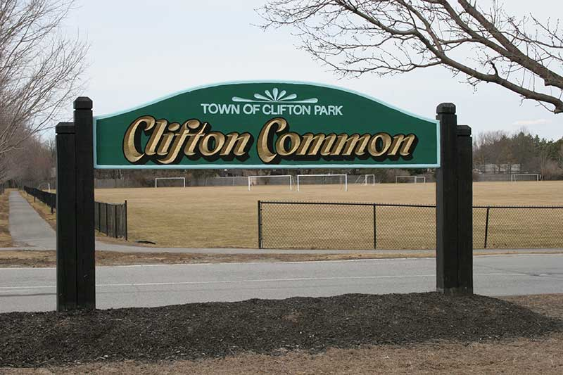 Entrance sign to the Clifton Common park and fields