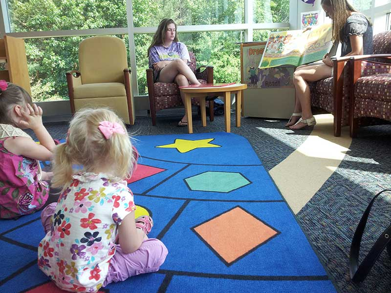 Children enjoying story time at the Clifton Park Library