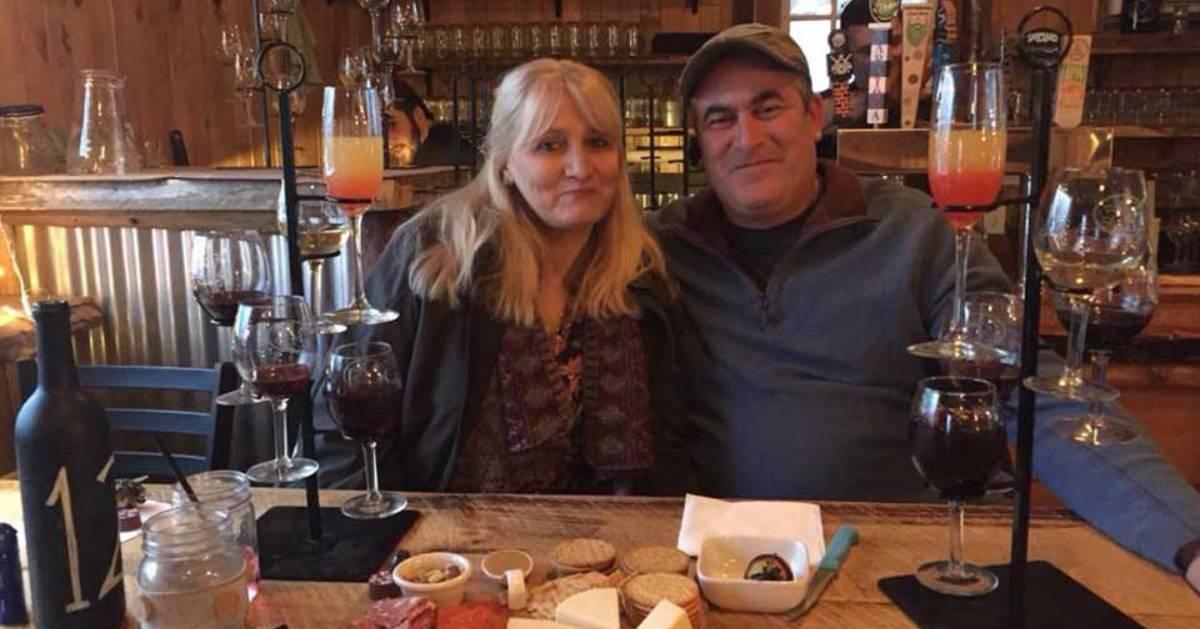 man and woman at wine tasting