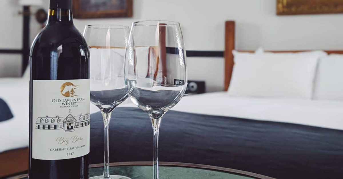 wine bottles and glasses in a hotel room