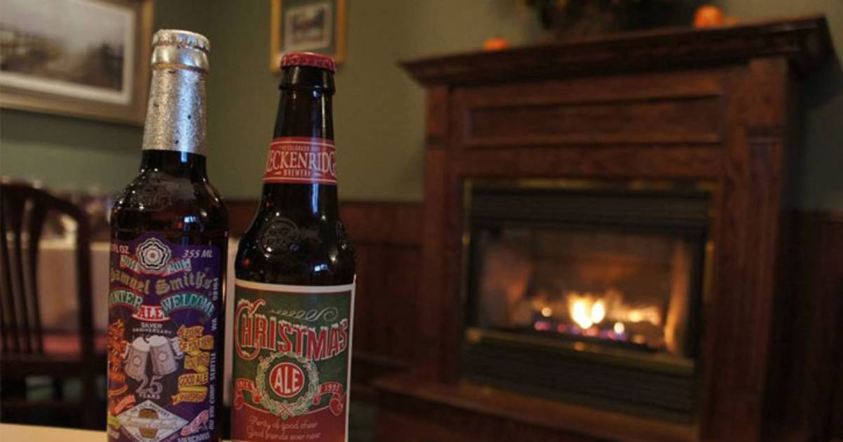 two bottles of beer and a fireplace in the back of the room