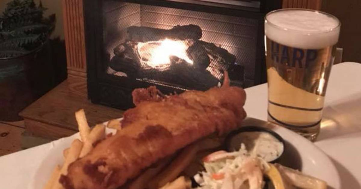 beer and fried fish by a fireplace