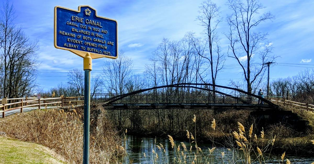 Erie Canal sign by bridge