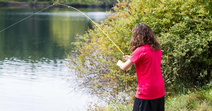 girl in a red shirt fishing