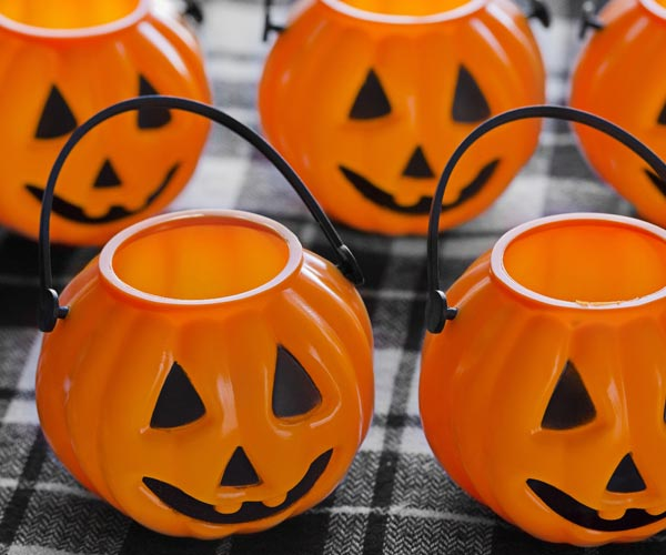 mini jack-o-lanterns on a tablecloth