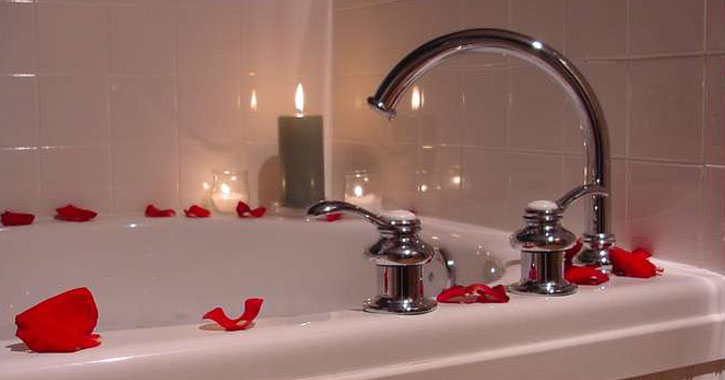 a bathtub with rose petals