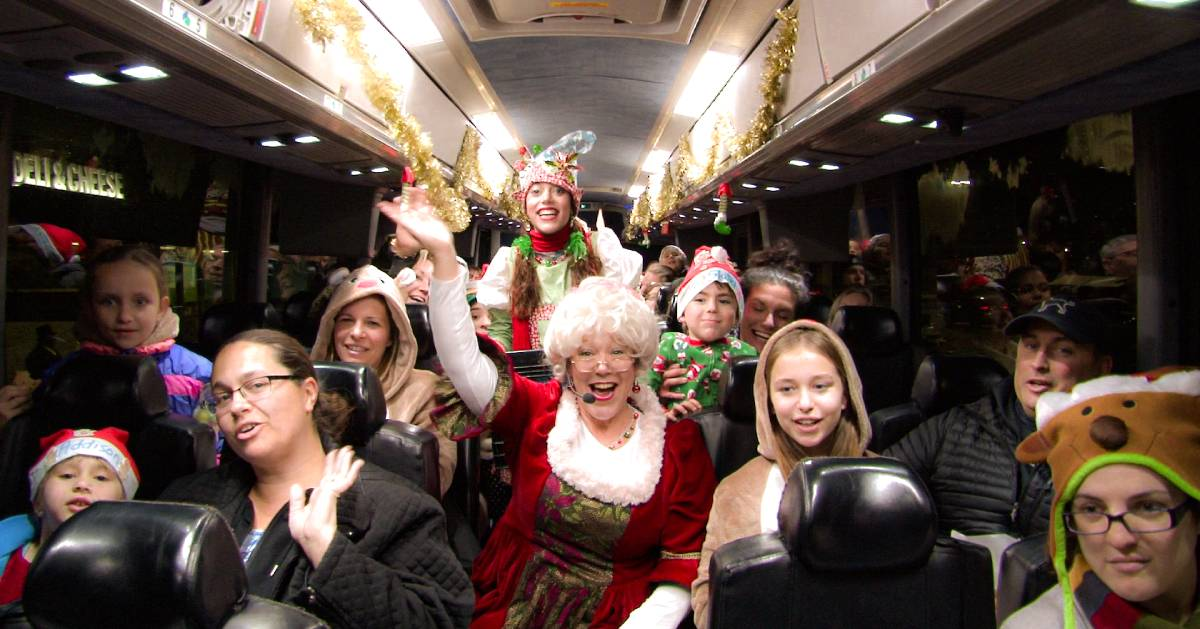people on holiday themed bus ride