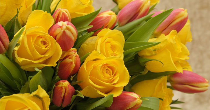 a bouquet of yellow and orange tulips