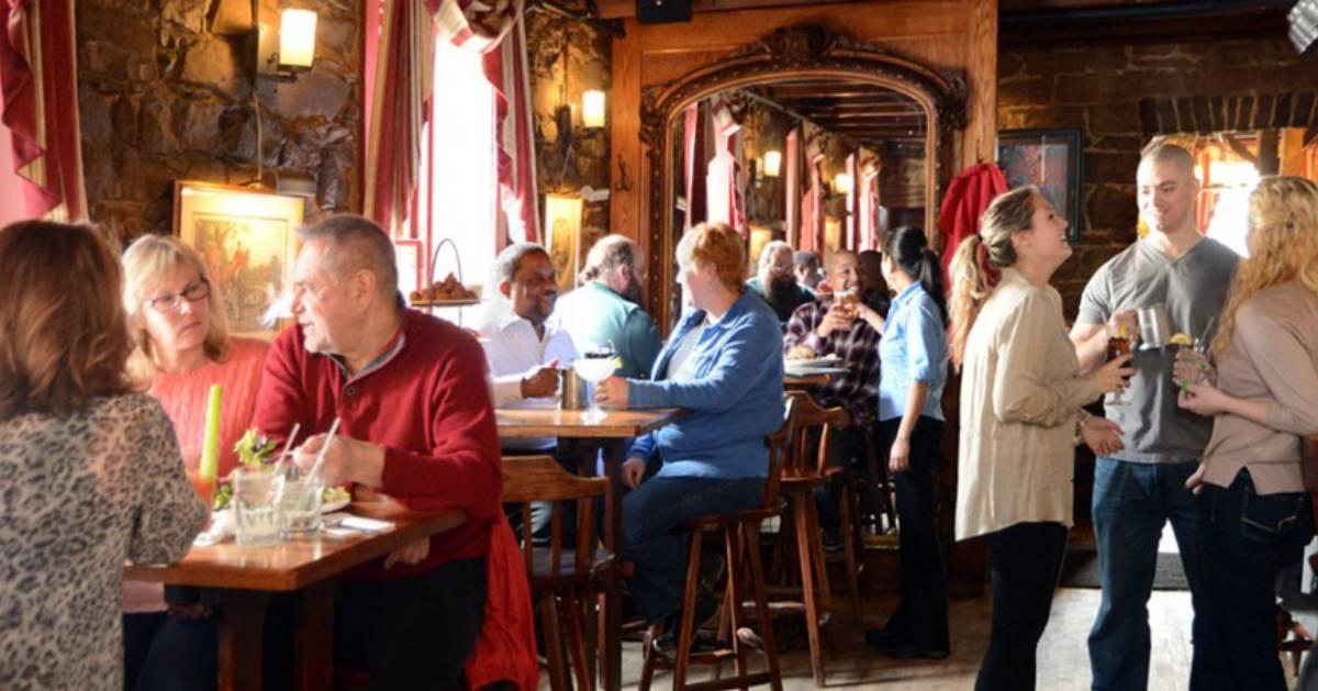people eating inside a restaurant room