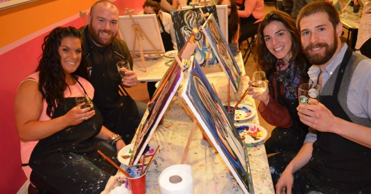 two men and two women at paint and sip table