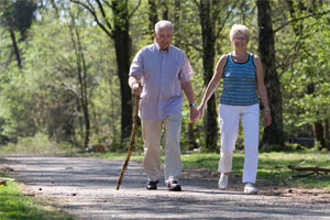 two seniors walking along a path