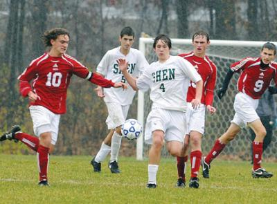 high school socer players play in rainy game