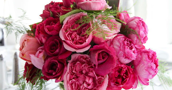 an arrangement of beautiful flowers in different shades of pink