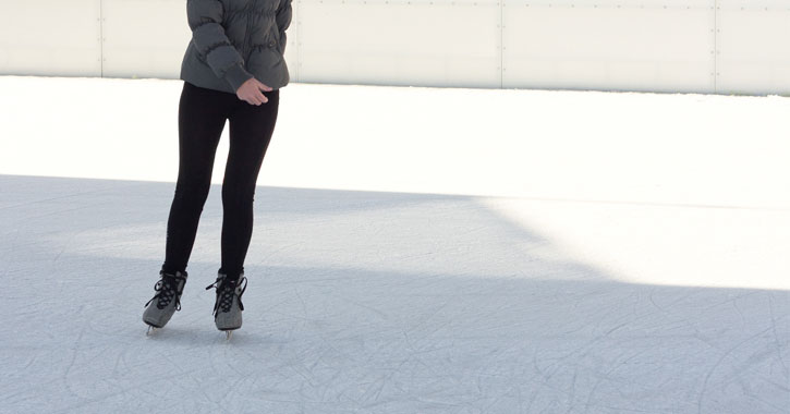 a woman skating, her head is out of view