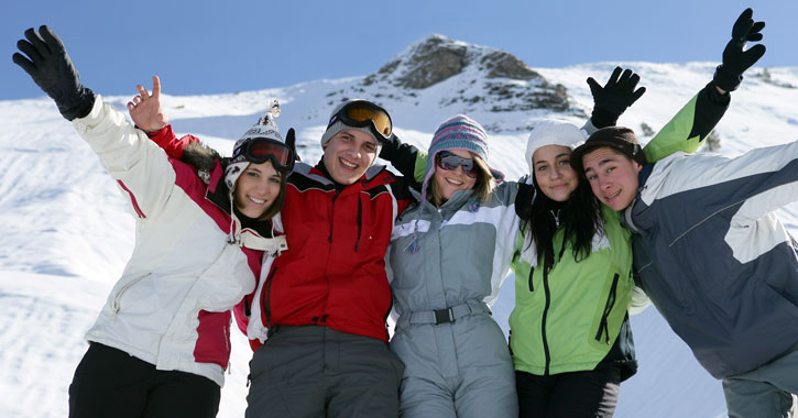 a group of friends posing together on a ski trip