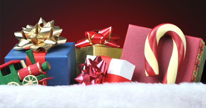 close up of gifts stuffed into a stocking