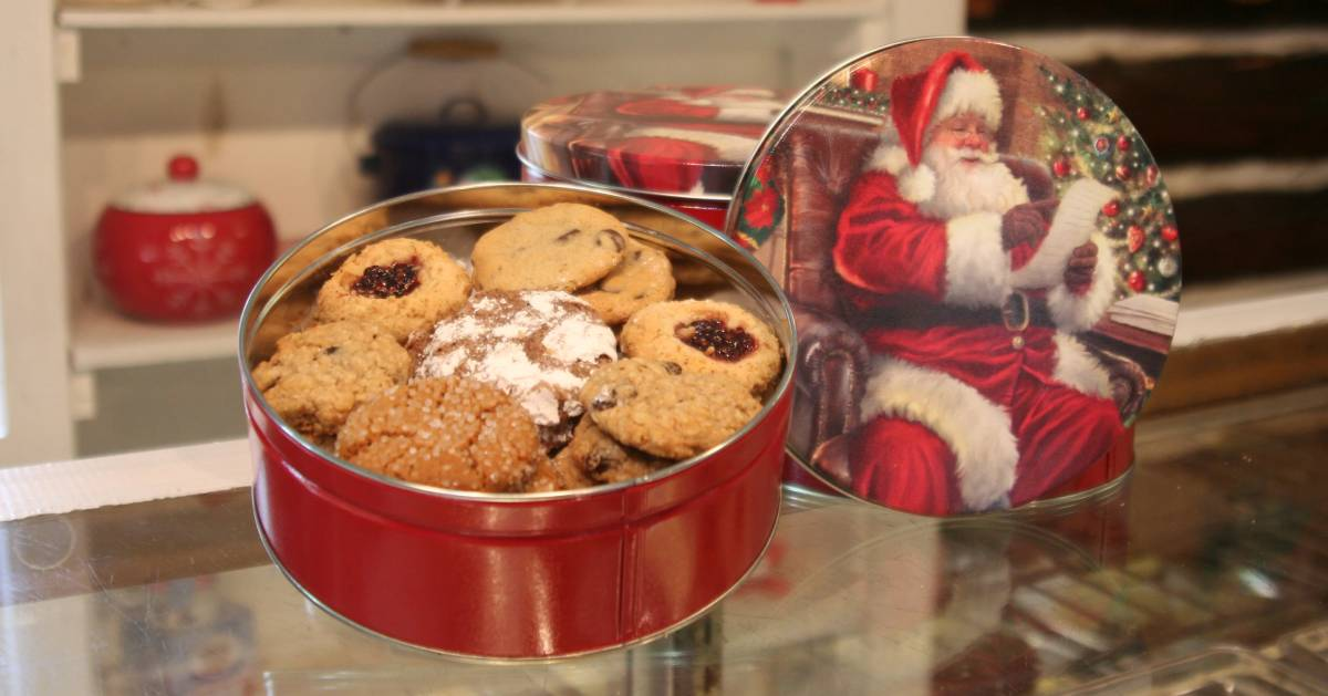 a tin of holiday cookies