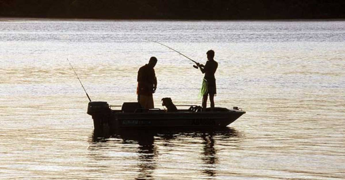 two people in small boat fishing