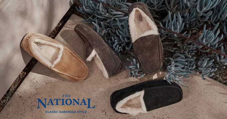 UGG slippers around the Christmas tree with The National text