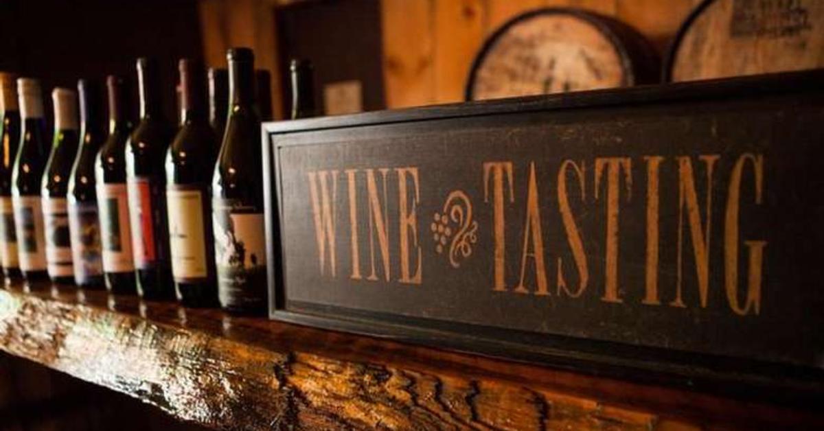 wine bottles and wine tasting sign