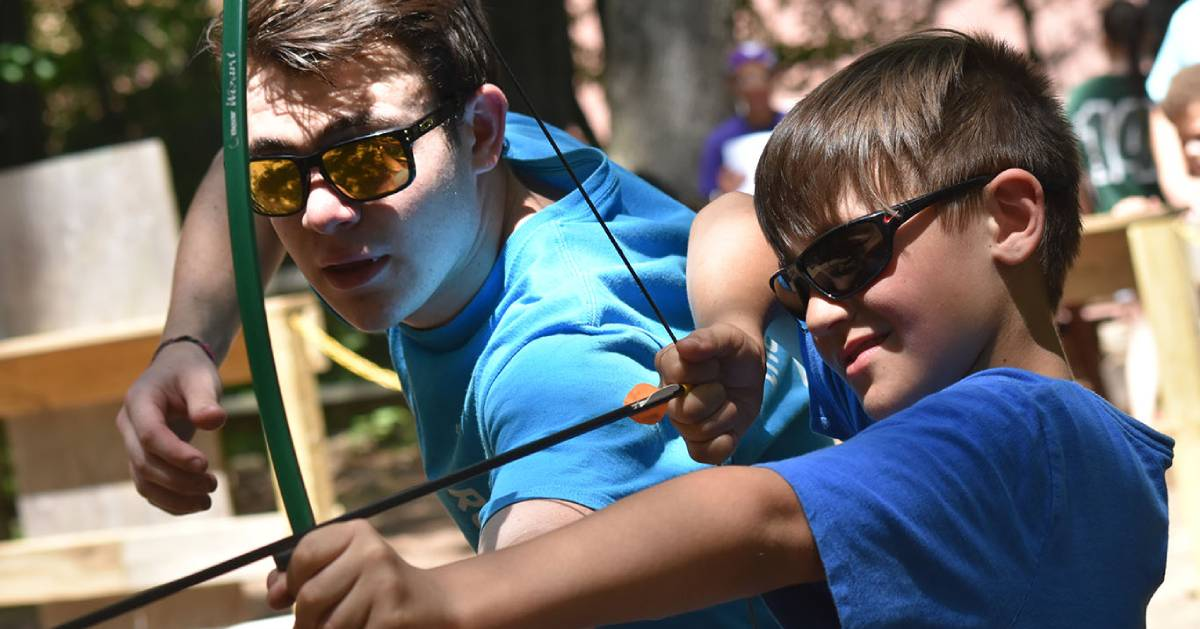 boy trying archery