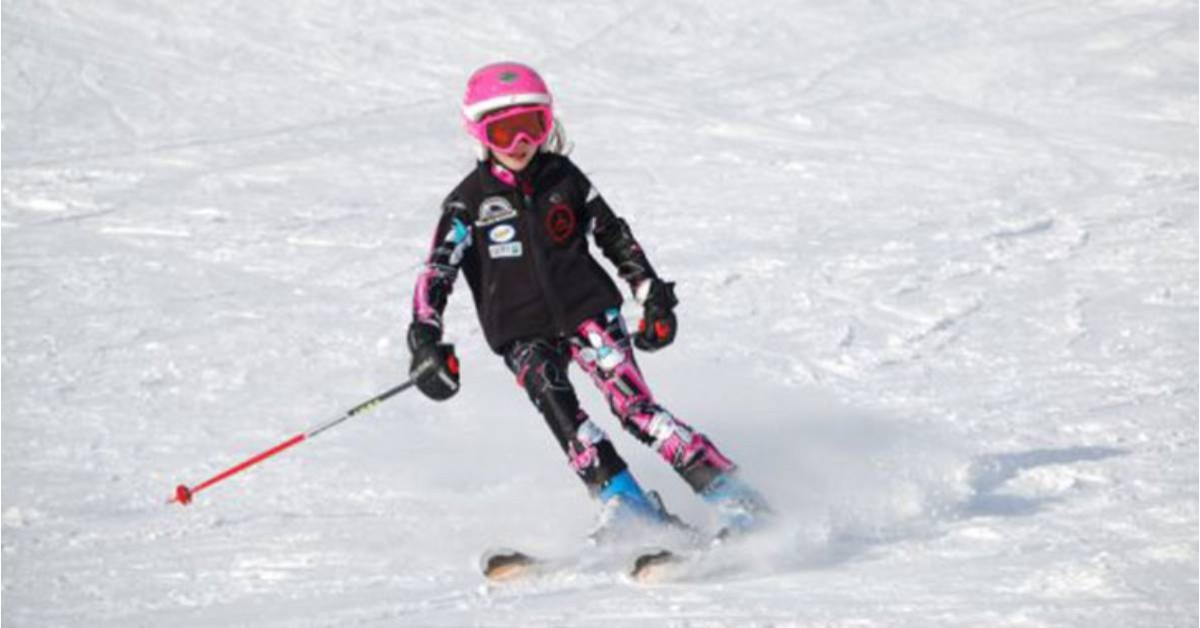 a young girl downhill skiing