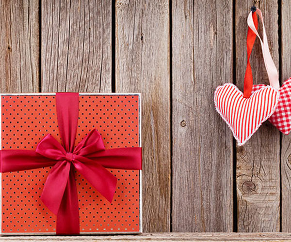 valentines day themed items on a wood background